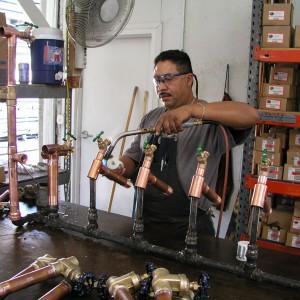 Can Am plumbing tech preparing kits at the warehouse